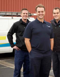 three of our Kendall plumbers standing ready by their truck
