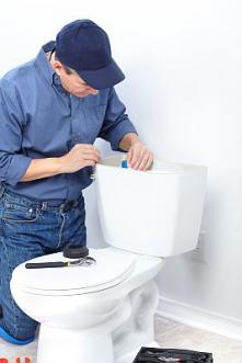 Mike is fixing a broken toilet